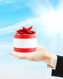 Man holds the gift on his palm Stock Photos
