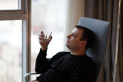 Man holds glass of whiskey Royalty Free Stock Photo