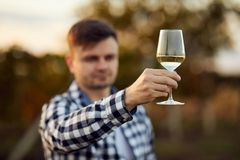 Man holds a glass of white wine stock image
