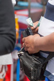 The man holds in hand a purse with money Royalty Free Stock Image