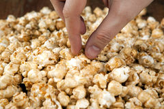 Man holds a handful of popcorn in his hands. Close up stock images