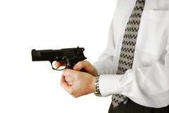 The man holds handgun Stock Photos