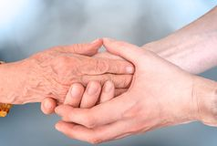 Man holds hands of eldery woman. Senior help and assistance concept Royalty Free Stock Photography