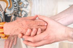 Man holds hands of eldery woman. Senior help concept Royalty Free Stock Images