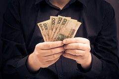 Man holds hands Polish money Stock Photography