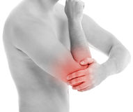 Man holds his back due to pain Stock Images