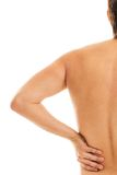 Man holds his back due to pain Royalty Free Stock Photography