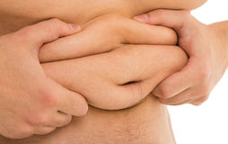Man holds his fat tummy Stock Photography