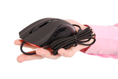 Man holds in his hand black computer optical mouse Stock Photo