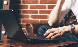 A man is holds his hand on the laptop`s touchpad. royalty free stock photography