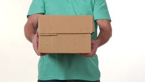 Man holds in his hands a big box on a white background. 5 stock video footage
