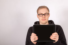 A man holds his tablet computer in the camera Royalty Free Stock Images