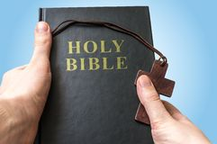 Man holds Holy Bible in hands Royalty Free Stock Photos