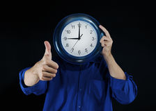 Man holds hours Stock Photos
