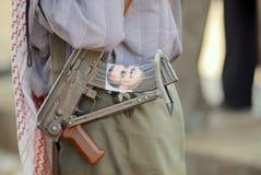 Man holds Kalashnikov machine gun, Hadramaut valley, Yemen Stock Photo