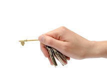 Man holds a key Stock Photos