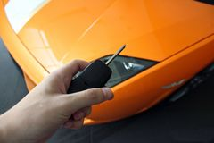 Man holds the key of a luxury car. royalty free stock image