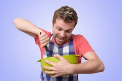 Man holds kitchenware cooking with curious face stock image