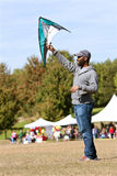 Man Holds Kite High To Get It Airborne At Festival Royalty Free Stock Photos