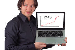 A man holds a laptop in hand. A businessman holds a laptop in hand and holds a presentation Royalty Free Stock Photos