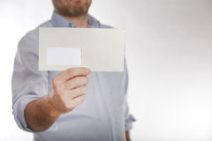 Man holds a letter into the camera royalty free stock images