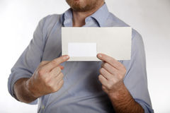 Man holds a letter into the camera Royalty Free Stock Photography