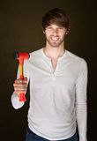 Man Holds Mallet. Smiling young Caucasian male with red mallet Stock Photography