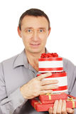 Man holds many gifts Royalty Free Stock Photos