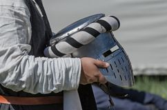 Man holds medieval knight iron helmet Stock Photography