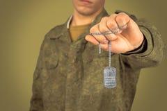 Man holds metallic badge Stock Photography