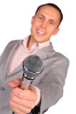 Man holds microphone in hand Stock Photo