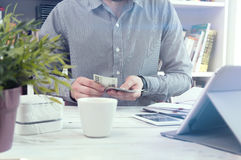 Man holds money. Conception of home budget Royalty Free Stock Images