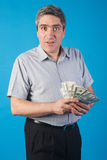 Man holds money in hand Royalty Free Stock Images
