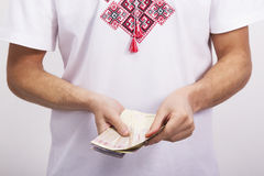 Man holds money in hands Stock Photo