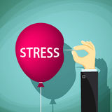 Man holds a needle and a red balloon with the word stress.  Royalty Free Stock Photography