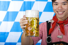 Man holds Oktoberfest beer stein (Mass) Stock Photos
