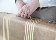 Man holds old suitcase Stock Photos