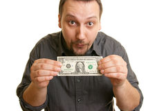 Man holds one dollar bill. Man holds the bill of one U.S. dollars Royalty Free Stock Image