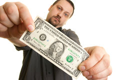 Man holds one dollar bill. Man holds the bill of one U.S. dollars Stock Photos