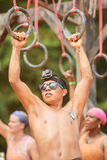 Man Holds Onto Suspended Rings At Extreme Obstacle Course Race Stock Photos