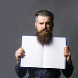 Man holds open journal Stock Images