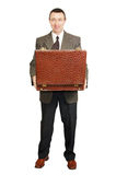 Man holds an open suitcase Royalty Free Stock Photo