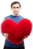 A man holds out a big red heart Royalty Free Stock Photos