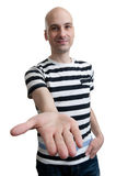 Man holds out his hand with the palm facing upwards. Casual man holds out his hand with the palm facing upwards isolated on white background Royalty Free Stock Photography