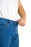 Man holds out waistline with pride Royalty Free Stock Image