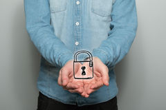 Man holds a padlock symbol royalty free stock images