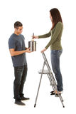 Man Holds Paint Can As Woman Paints From Stepladder Stock Photos
