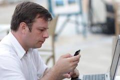 Man holds phone Stock Photos