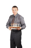 Man holds a pie with burning candles Stock Image