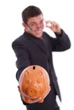 Man holds a piggy bank Stock Image